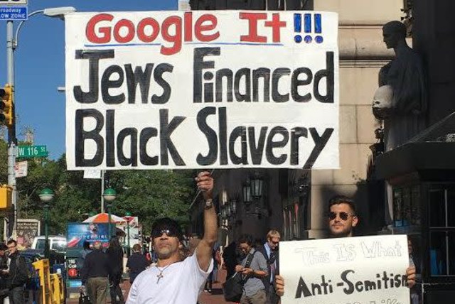 "In October 2016, an individual held a sign and walked around the campus gates that said, ""Google it!!! Jews financed black slavery."" (photo credit: Courtesy)"
