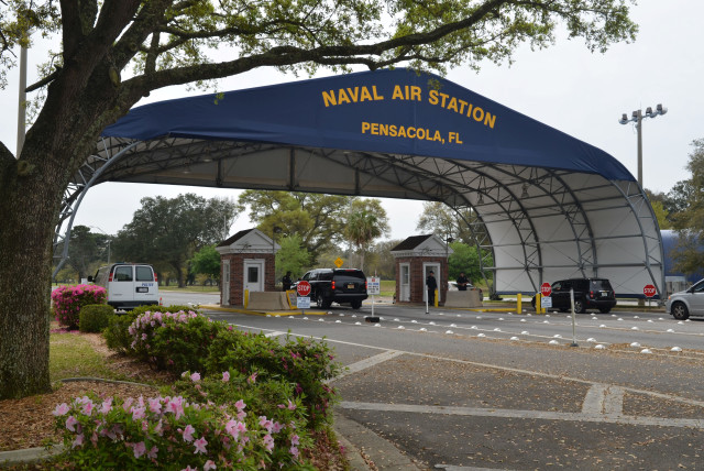 The main gate at Naval Air Station Pensacola is seen on Navy Boulevard in Pensacola, Florida, U.S. March 16, 2016. Picture taken March 16, 2016 (photo credit: U.S. NAVY/PATRICK NICHOLS/HANDOUT VIA REUTERS)