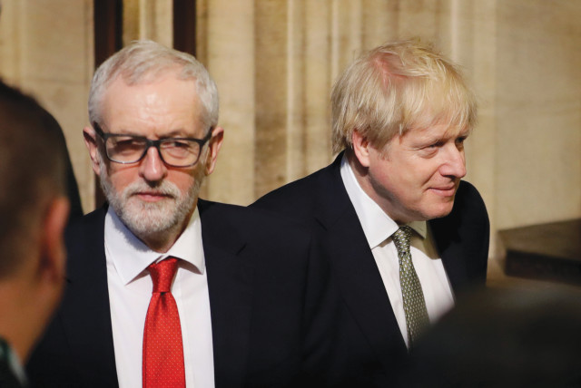 BRITAIN'S PRIME Minister Boris Johnson and Labour Party Leader Jeremy Corbyn walk through the Commons Members Lobby after the Queen's Speech at the State Opening of Parliament ceremony at the Palace of Westminster in London in December. (photo credit: REUTERS)