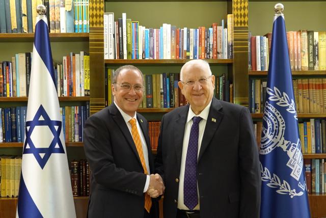 "Ben-Gurion University of the Negev President Prof. Daniel Chamovitz presents the ""50th Anniversary of Ben-Gurion University of the Negev"" stamp to Israeli President Reuven Rivlin (Credit: President of Israel's Spokesperson's Unit)"