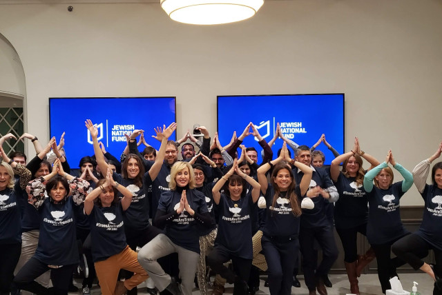 The JNF-USA team do the 'yoga tree' pose to promote Tu BiShvat (photo credit: JNF USA)