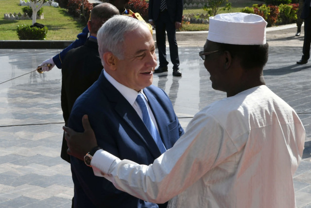 Israeli Prime Minister Benjamin Netanyahu is greeted by Chad's President Idriss Deby upon his arrival in N'Djamena, Chad January 20, 2019 (photo credit: KOBI GIDEON/GOVERNMENT PRESS OFFICE/HANDOUT VIA REUTERS)