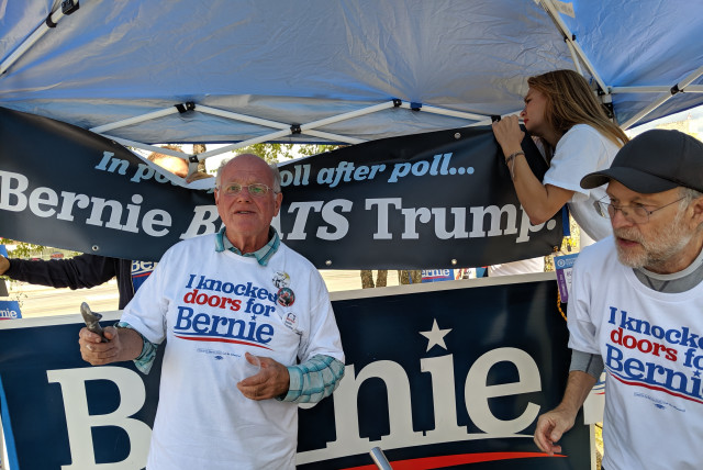 Ben & Jerry's Ice Cream founders Ben Cohen (left) and Jerry Greenfield prepare to scoop ice cream for Bernie Sanders supporters outside the New Hampshire State Democratic Convention in September 2019. (Credit: Darren Garnick)