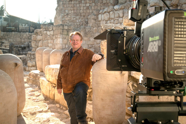 CBN CEO Gordon Robertson on the Ophel in Jerusalem's Davidson Center. Archeologist Eilat Mazar believes this area to be a bakery in the royal palace of King Solomon. The large jars were used to store flour, oil and date honey for the royal bakery. (photo credit: ERIN ZIMMERMAN)