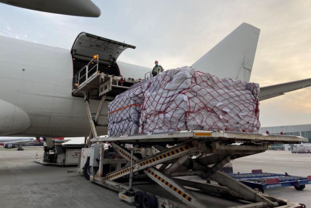A Cal Cargo jet being loaded in China with medical gear on the way to Israel to fight coronavirus  (photo credit: DEFENSE MINISTRY)