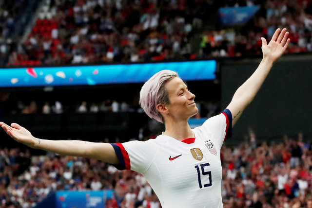 Megan Rapinoe of the U.S. celebrates scoring their first goal during the France v United States game during the Women's World Cup Quarter Final at Parc des Princes, Paris, France June 28, 2019. (photo credit: BENOIT TESSIER /REUTERS)
