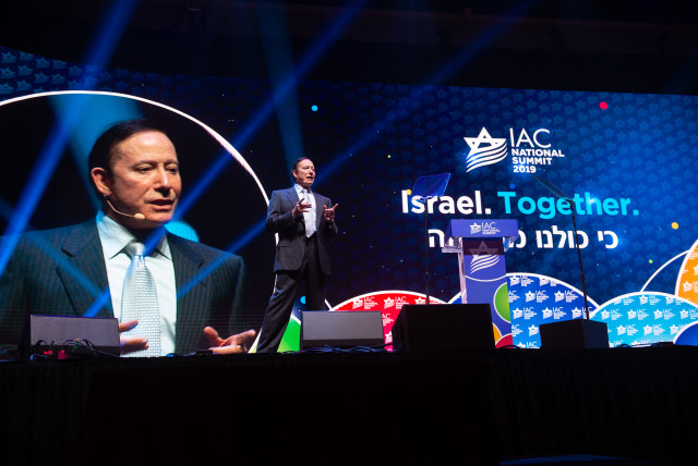 Adam Milstein addresses the Israeli-American Council National Summit, which took place in Maimi, Florida, in December 2019 (photo credit: NOAM GALAI)