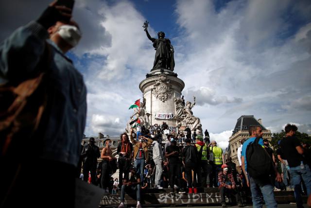 Demonstrators attend a protest at the Place de la Republique square in Paris, France June 13, 2020. (photo credit: BENOIT TESSIER/REUTERS)