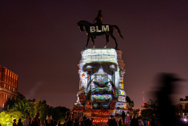 An image of George Floyd is projected on the statue of Confederate General Robert E. Lee in Richmond, Virginia, U.S. June 20, 2020 (photo credit: REUTERS)