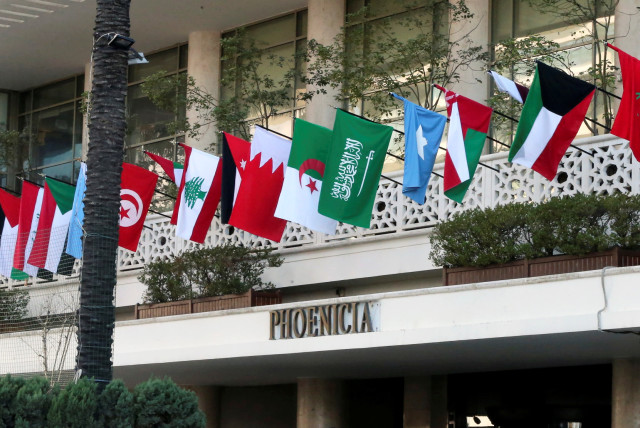 Flags of Arab League member countries on display at Beirut's Phoenicia Hotel, Lebanon January 18, 2019 (photo credit: MOHAMED AZAKIR / REUTERS)