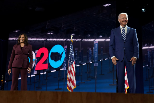 U.S. Senator Kamala Harris (D-CA) is joined on stage by her running-mate, U.S Democratic presidential nominee Joe Biden, after she accepted the Democratic vice presidential nomination during an acceptance speech delivered for the largely virtual 2020 Democratic National Convention from the Chase Cen (photo credit: REUTERS/KEVIN LAMARQUE)
