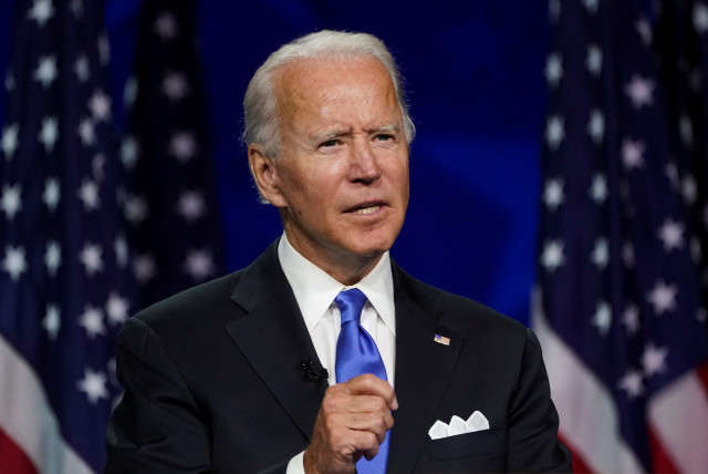 Former U.S. Vice President Joe Biden accepts the 2020 Democratic presidential nomination during a speech delivered for the largely virtual 2020 Democratic National Convention from the Chase Center in Wilmington, Delaware, U.S., August 20, 2020 (photo credit: REUTERS/KEVIN LAMARQUE)