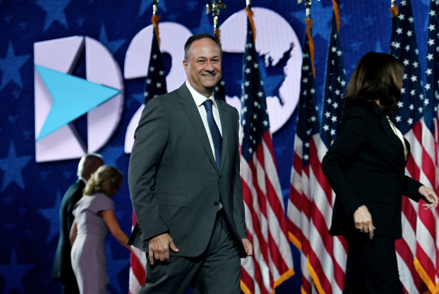 Douglas Emhoff walks off stage with his wife, Sen. Kamala Harris, at the end of the last day of the Democratic National Convention, at the Chase Center in Wilmington, Del., Aug. 20, 2020.  (photo credit: OLIVIER DOULIERY / AFP / REUTERS)