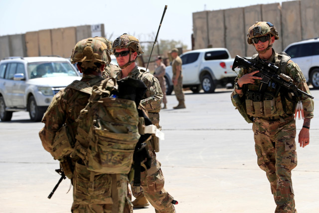 U.S. soldiers are seen during a handover ceremony of Taji military base from US-led coalition troops to Iraqi security forces, in the base north of Baghdad, Iraq August 23, 2020. (photo credit: THAIER AL-SUDANI/REUTERS)