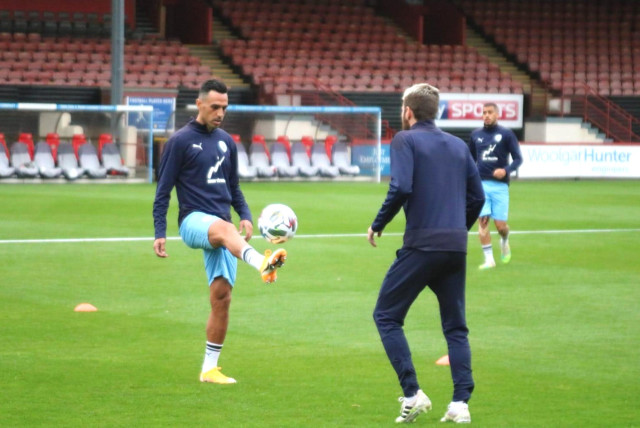 ERAN ZAHAVI practices ahead of Israel's Nations League matches against Scotland and Slovakia, in which Willi Ruttensteiner (inset) will make his debut as the blue-and-white National Team head coach (photo credit: ISRAEL FOOTBALL ASSOCIATION)