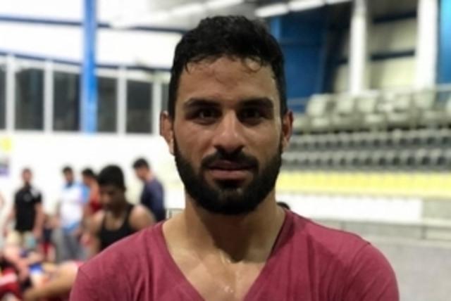 Iranian Greco-Roman wrestler Navid Afkari. (photo credit: Wikimedia Commons)
