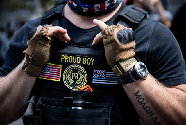 Proud Boys and supporters of the police participate in a protest in Portland, Oregon, U.S., August 22, 2020 (photo credit: REUTERS/MARANIE STAAB)