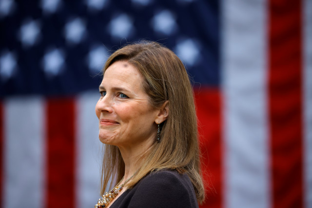 US Court of Appeals for the Seventh Circuit Judge Amy Coney Barrett reacts as US President Donald Trump holds an event to announce her as his nominee to fill the Supreme Court seat left vacant by the death of Justice Ruth Bader Ginsburg. September 26, 2020.  (photo credit: CARLOS BARRIA / REUTERS)
