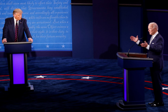 US President Donald Trump and Democratic presidential nominee Joe Biden participate in their first 2020 presidential campaign debate held on the campus of the Cleveland Clinic at Case Western Reserve University in Cleveland, Ohio, US (photo credit: BRIAN SNYDER / REUTERS)