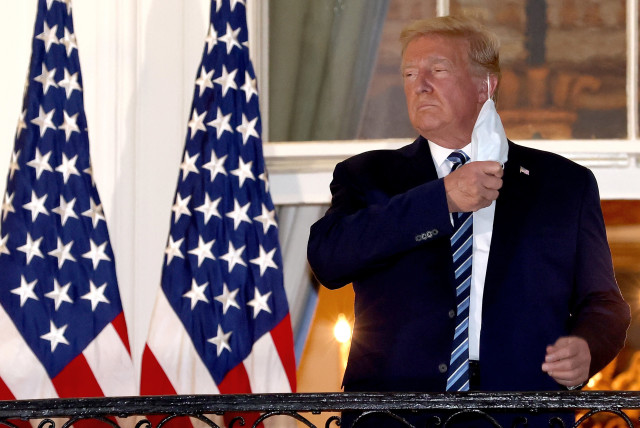 US PRESIDENT Donald Trump removes his mask upon return to the White House on Monday from Walter Reed National Military Medical Center, where he spent three days hospitalized for coronavirus.  (photo credit: WIN MCNAMEE/GETTY IMAGES/TNS)