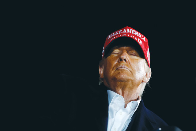 US PRESIDENT Donald Trump attends a campaign rally at Des Moines International Airport in Iowa on Wednesday.  (photo credit: REUTERS)