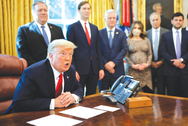 Us President Donald Trump uses a speakerphone to talk with leaders of Israel and Sudan, in the Oval Office at the White House last month. (photo credit: CARLOS BARRIA / REUTERS)