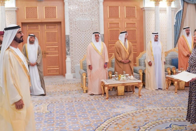 Canadian Ambassador to the UAE Marcy Grossman delivers her credentials to Dubai ruler Sheikh Mohammed Bin Rashid Al Maktoum in 2018. (photo credit: DUBAI GOVERNMENT MEDIA OFFICE)