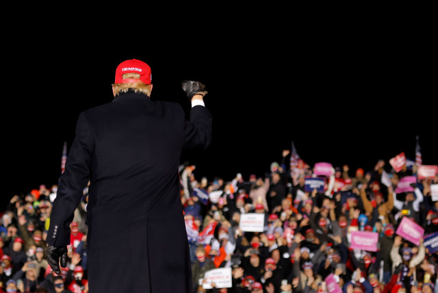 US President Donald Trump holds a campaign rally at Gerald R. Ford International Airport in Grand Rapids, Michigan (photo credit: CARLOS BARRIA / REUTERS)