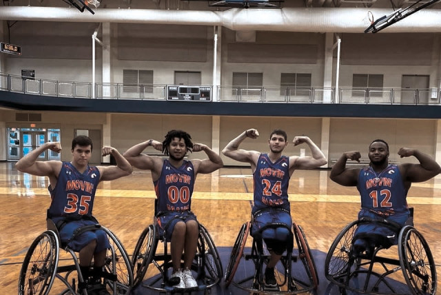 Israeli teenager Amit Vigoda (#24) is studying at the University of Texas at Arlington while playing hoops for the school in the National Wheelchair Basketball Association.  (photo credit: USTA/COURTESY)