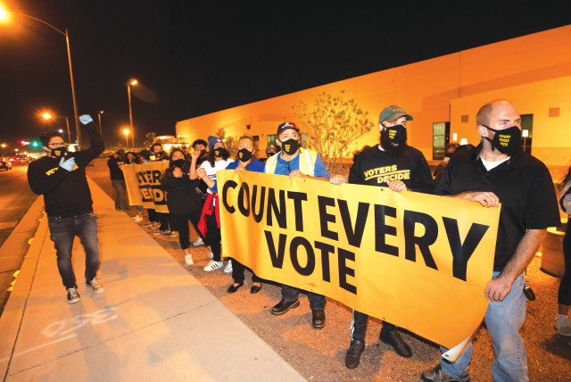 COUNTER-PROTESTERS DEMONSTRATE against a 'Stop the Steal' protest by supporters of US President Donald Trump at the Clark County Election Center in North Las Vegas, Nevada, on Wednesday. (photo credit: STEVE MARCUS/REUTERS)