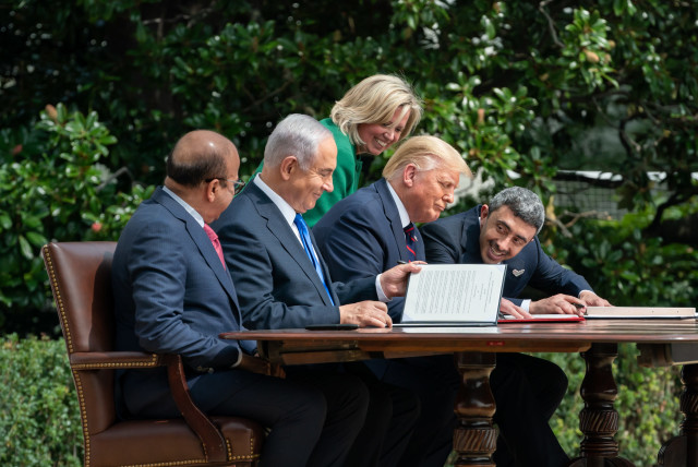 "US President Donald Trump (2nd R), Israeli Prime Minister Benjamin Netanyahu (2nd L), UAE Foreign Minister Abdullah bin Zayed Al Nahyan (R) and Bahrain Foreign Minister Abdullatif bin Rashid Al Zayani (L) attend a signing ceremony for the agreements on ""normalization of relations"" reached between Is (photo credit: (THE WHITE HOUSE/ANDREA HANKS/ANADOLU AGENCY VIA GETTY IMAGES))"