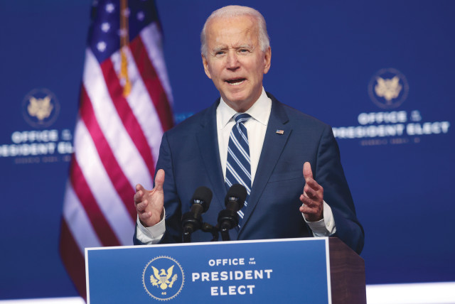 US PRESIDENT-ELECT Joe Biden speaks about healthcare at the theater serving as his transition headquarters in Wilmington, Delaware, on Tuesday. (photo credit: JONATHAN ERNST / REUTERS)