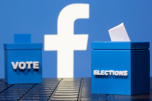 3D printed ballot boxes are seen in front of a displayed Facebook logo in this illustration taken November 4, 2020. (photo credit: REUTERS/DADO RUVIC/ILLUSTRATION/FILE PHOTO)