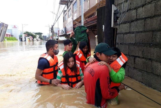 Philippine Coast Guard conduct a rescue operation, after Typhoon Vamco resulted in severe flooding, in the Cagayan Valley region in northeastern Philippines, November 13, 2020. Picture taken November 13, 2020.  (photo credit: PHILIPPINE COAST GUARD/HANDOUT VIA REUTERS)