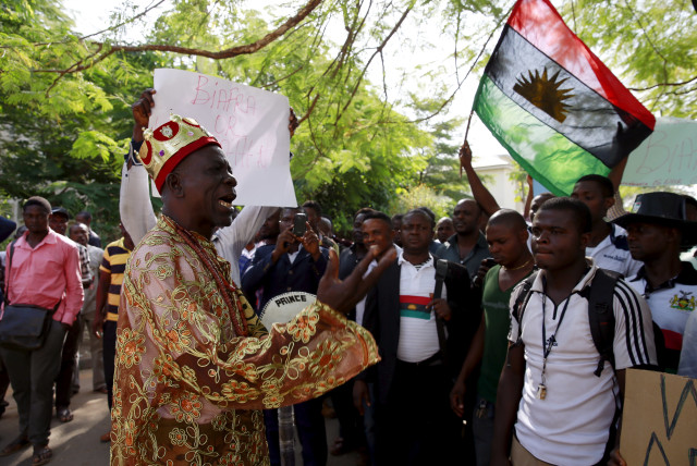 Traditional ruler Prince Ozo Onna joins supporters of Indigenous People of Biafra (IPOB) leader Nnamdi Kanu in a rally, as he is expected to appear at a magistrate court in Abuja, Nigeria December 1, 2015. Kanu - an activist who divides his time between the UK and Nigeria, spreading his ethos on soc (photo credit: REUTERS)