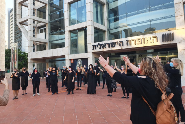 Singers from the opera chorus outside the Israeli Opera in Tel Aviv Wednesday (photo credit: Courtesy)