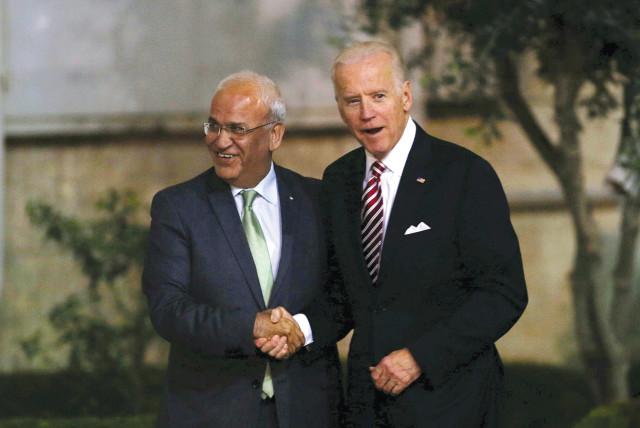 THEN-US vice president Joe Biden shakes hands with Palestinian chief negotiator Saeb Erekat upon Biden's arrival in Ramallah in 2016.  (photo credit: REUTERS)