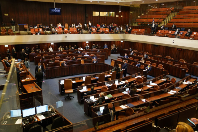 Lawmakers are seen in the Knesset plenum during the preliminary vote to dissolve the Knesset on December 2, 2020.. (photo credit: KNESSET SPOKESPERSON/DANI SHEM TOV)