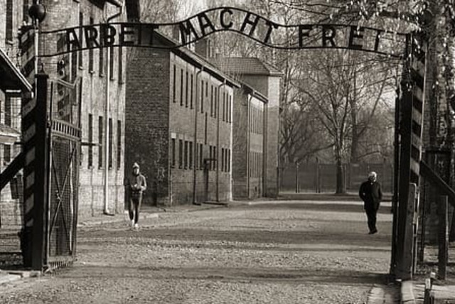 The main gate to Auschwitz with slogan 'Arbeit Macht Frei' (photo credit: PIKREPO)