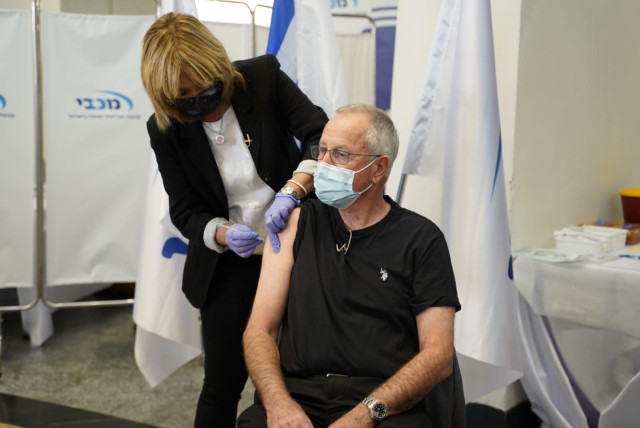 Maccabi Healthcare Services CEO Ran Saar receives the coronavirus vaccine (Credit: Courtesy Maccabi Healthcare Services)