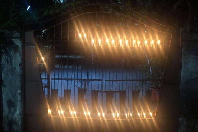 Residents of Yangon light candles outside their houses to show their disapproval of the recent military coup in Myanmar, Feb. 2, 2021. (photo credit: MON MON MYAT)