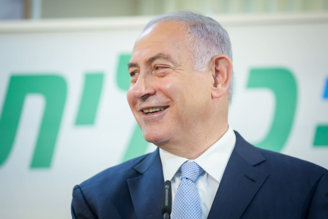 Prime Minister Benjamin Netanyahu is seen speaking at a Clalit vaccination center in Zarzir, on February 9, 2021. (photo credit: DAVID COHEN/FLASH 90)