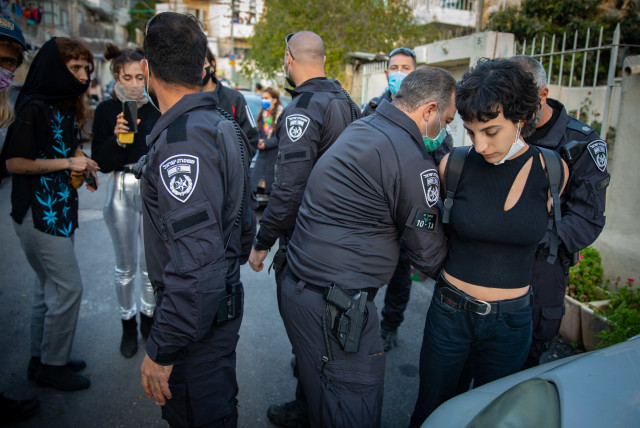 Israeli police officers close a street party during the Jewish holiday of Purim,to prevent large gatherings and the spread of Covid-19 virus in Jerusalem February 28, 2021.  (photo credit: OLIVIER FITOUSSI/FLASH90)