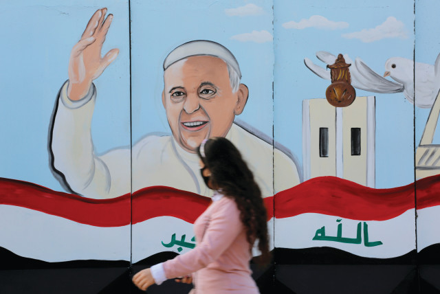 A MURAL of Pope Francis adorns a church wall ahead of his upcoming visit to Iraq, in Baghdad on February 22. (photo credit: TEBA SADIQ/FILE PHOTO/REUTERS)