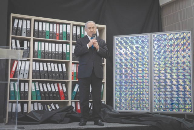 PRIME MINISTER Benjamin Netanyahu displays files that provided details of Iran's nuclear program, at a press conference in Tel Aviv in 2018. (photo credit: MIRIAM ALSTER/FLASH90)