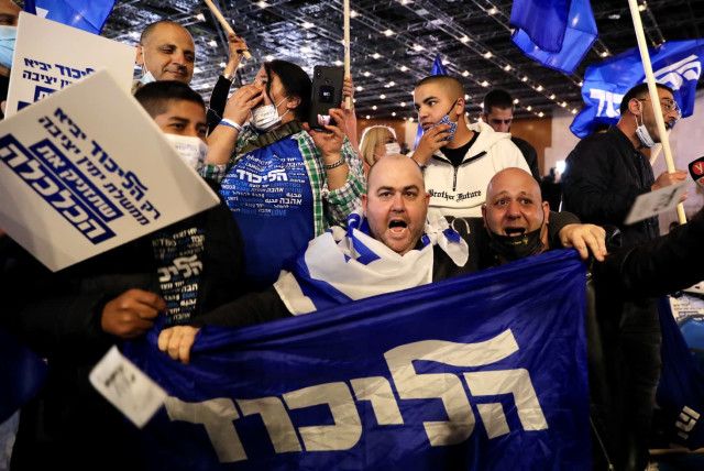 Likud supporters celebrate the exit polls, which give Prime Minister Benjamin Netanyahu a substantial lead. (photo credit: MARC ISRAEL SELLEM/THE JERUSALEM POST)
