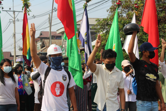 Demonstrators flash a three-finger salute during a protest against the military coup in Dawei, Myanmar April 13, 2021. Courtesy of Dawei Watch/via REUTERS (photo credit: COURTESY OF DAWEI WATCH/VIA REUTERS)