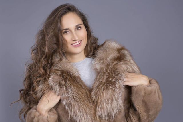 A woman is seen wearing a fur coat. (photo credit: PIXABAY)