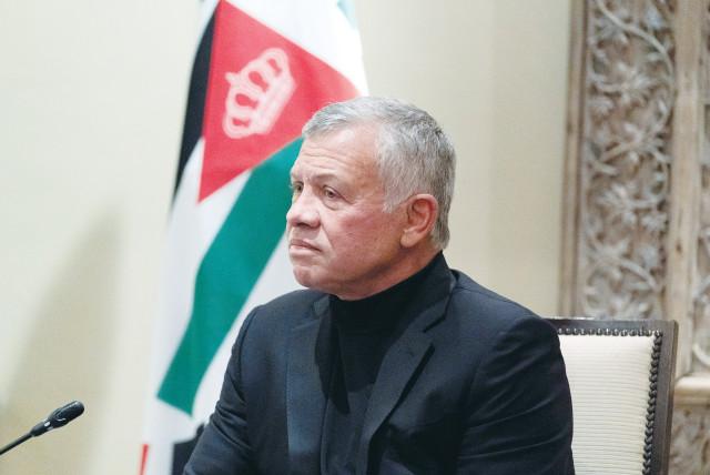 JORDAN'S KING ABDULLAH II listens during a meeting in Amman in May. (photo credit: ALEX BRANDON/POOL VIA REUTERS)