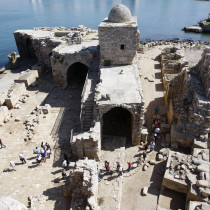 Tourists walk at the sea castle of the port-city of Sidon, southern Lebanon October 3, 2011.